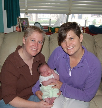 Cindy (left) and Marianne (right) with newly adopted daughter Kestin.|Cindy visits with Kestin in the Neonatal|Marianne holds new daughter Kestin|