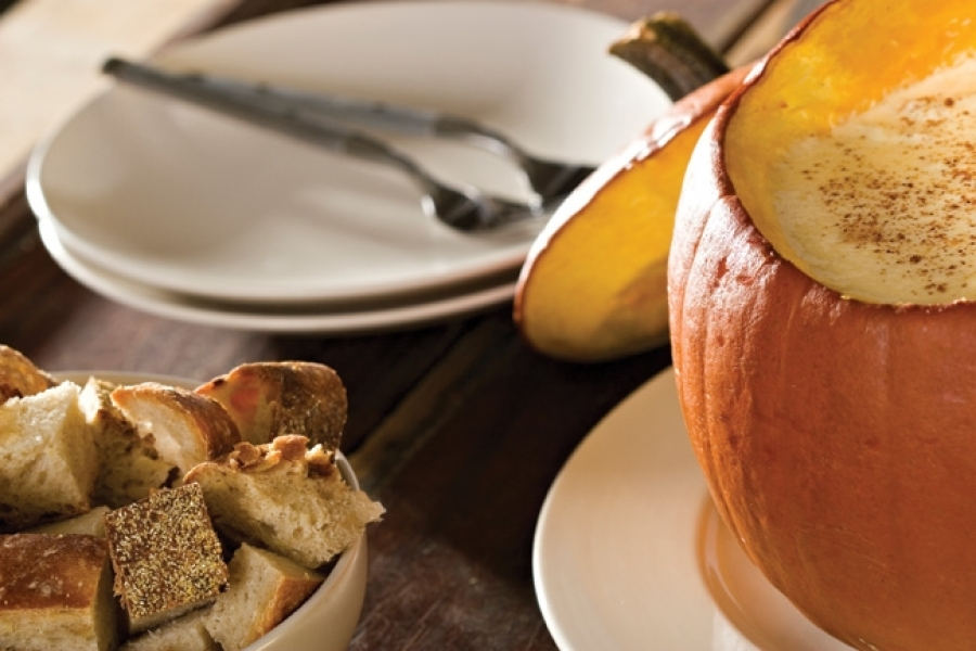 Dip or fondue served from a festive carved pumpkin is a great way to integrate your autumn theme into the menu.
